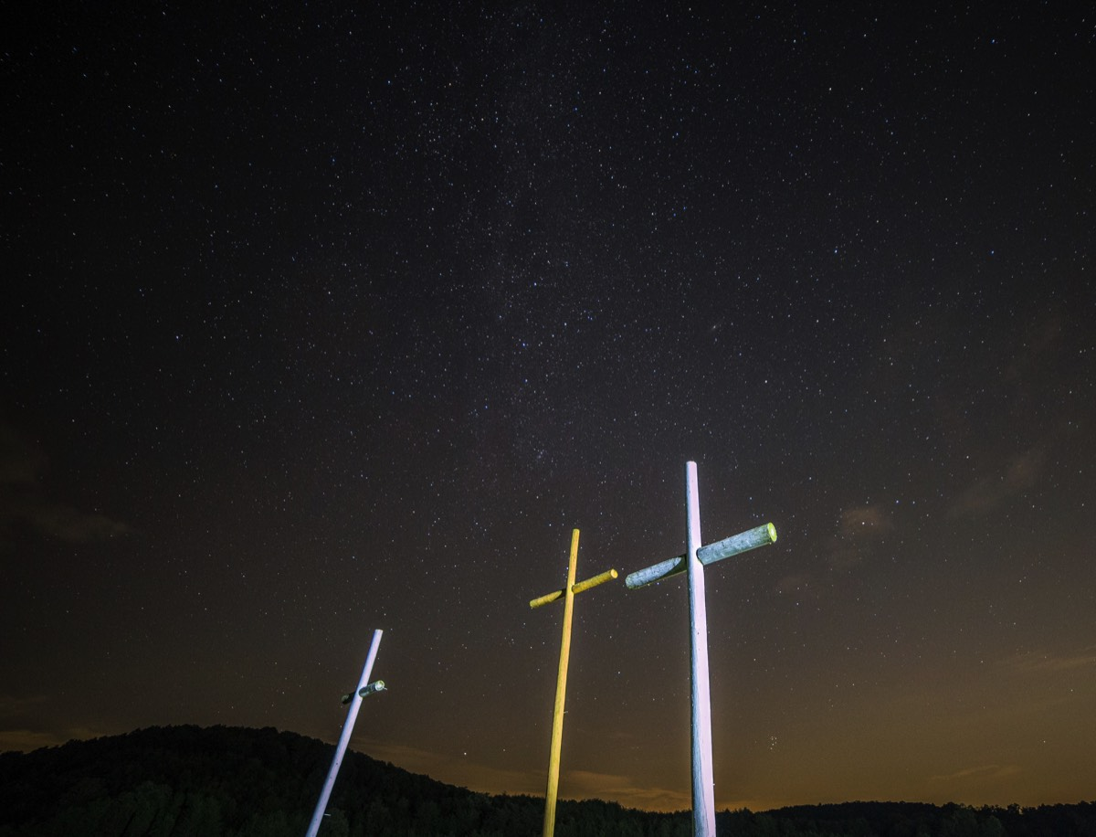 Three crosses against a starry sky